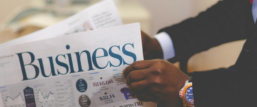 Photo of man reading a business newspaper
