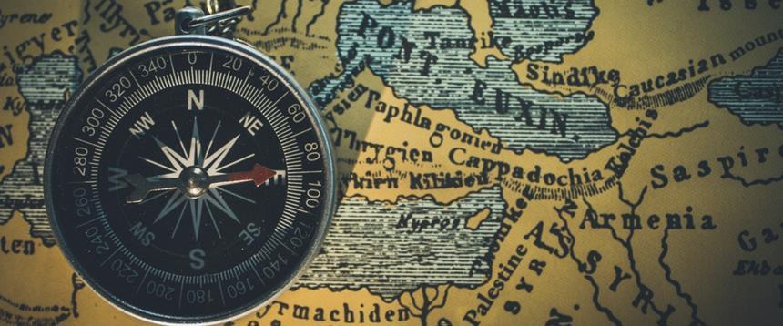 Photo of a compass and map