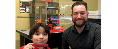Photo of librarian and you patron with Mountain View 3-D Printer