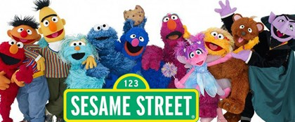 Photo of Sesame Street characters and street sign