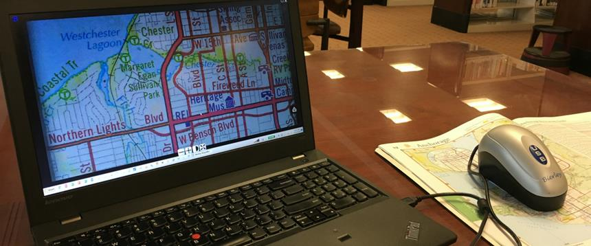 Electronic magnifier showing enlarged map on laptop screen.