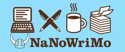 NaNoWriMo: picture of computer, pens, mug, papers and viking helmet