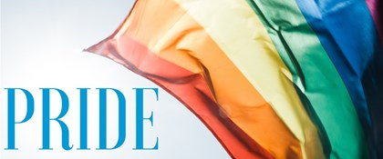 Photo of rainbow flag with text: Pride