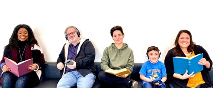 Photo of adults, teen, and child hold books or listening to audio books.