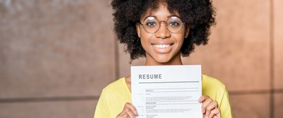 Photo of woman smiling and holding resume